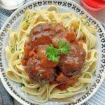 beef bourguinon meatballs on a plate of pasta