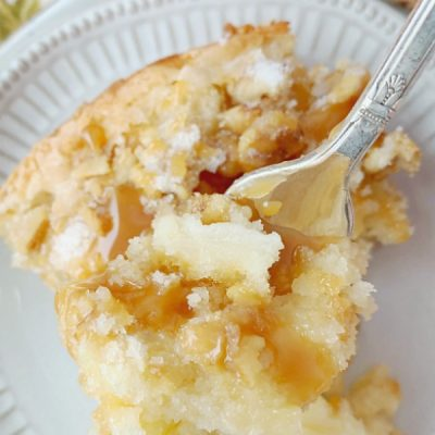 slice of french country apple cake drizzled with caramel sauce