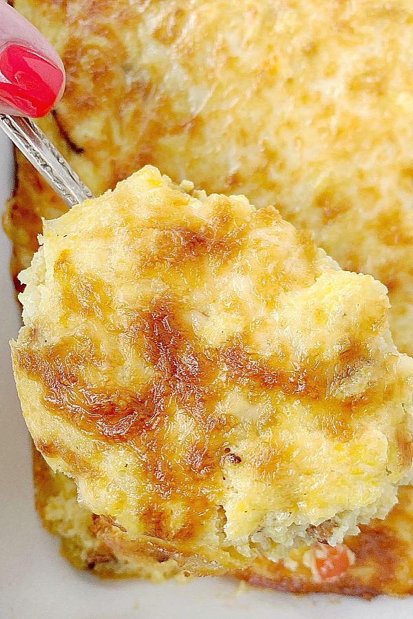 spoonful of loaded grits breakfast casserole