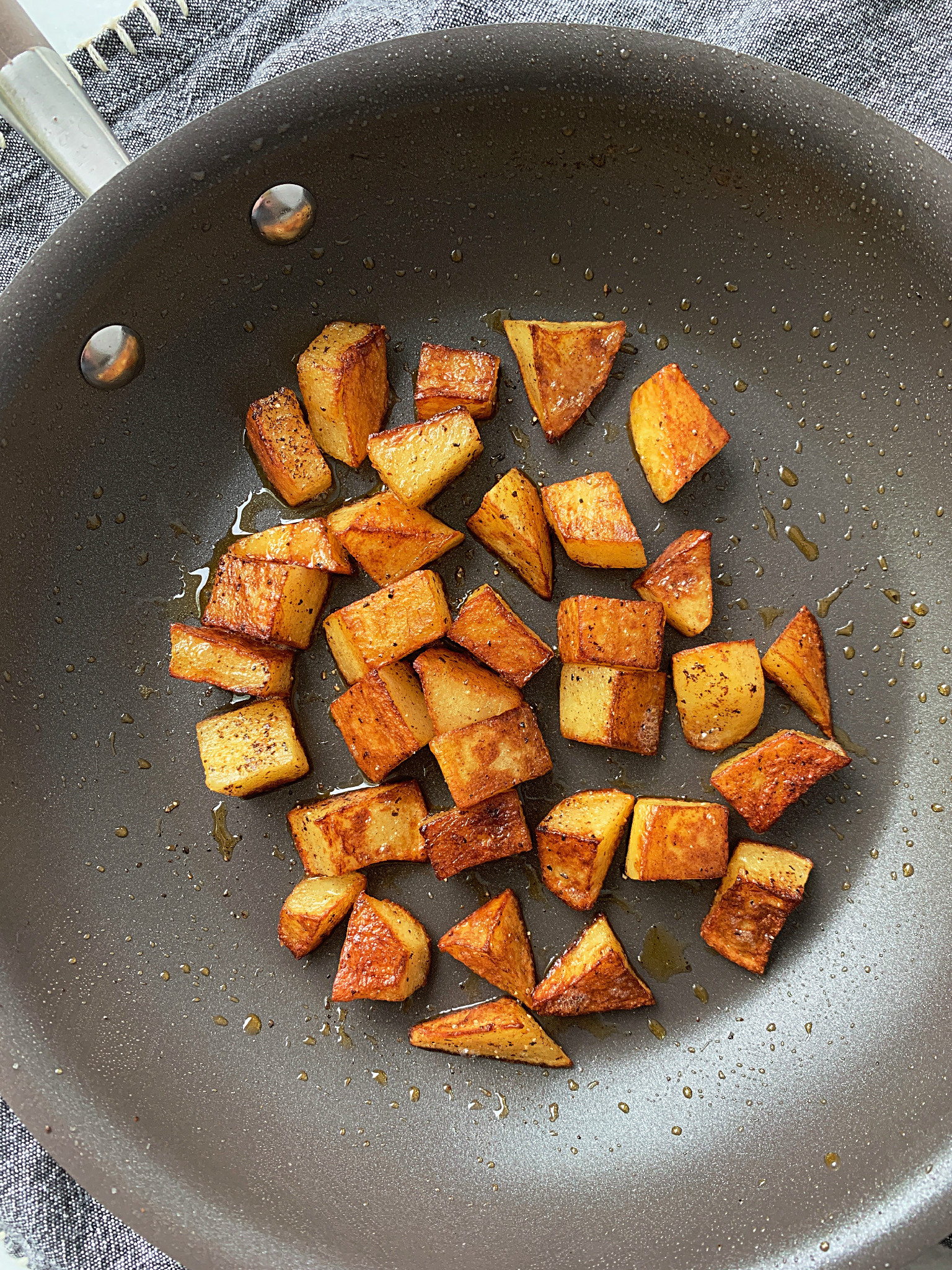 overhead view of breakfast potatoes in skillet