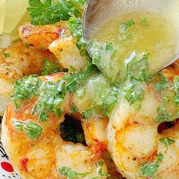 pouring butter over shrimp