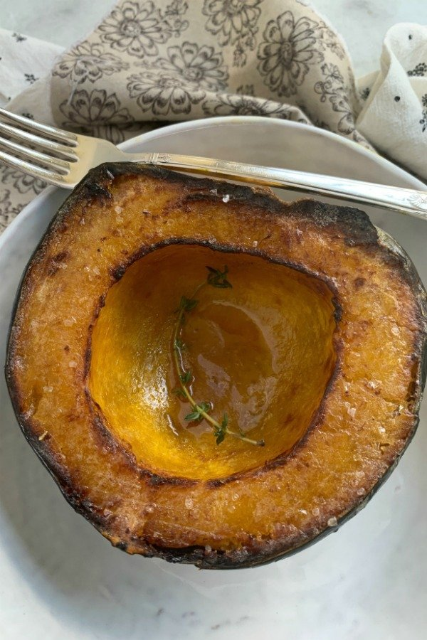 overhead view of air fryer acorn squash