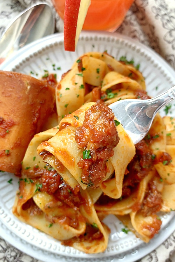 forkful or osso buco ragu with pasta