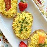 overhead view of creamy scrambled egg toasts