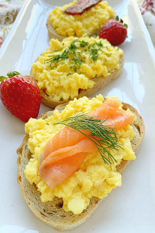 creamy scrambled egg toasts on a platter