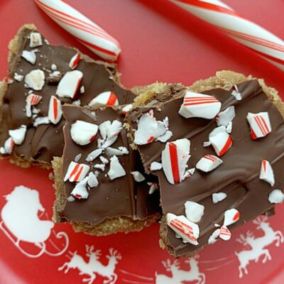 chocolate chip cookie candy crackle on a plate with candy cane