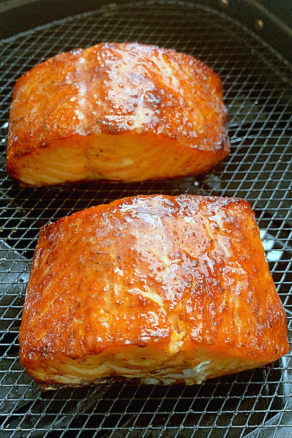 cooked salmon filets in the air fryer basket