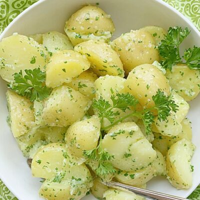 overhead view of parsley potatoes in a bowl