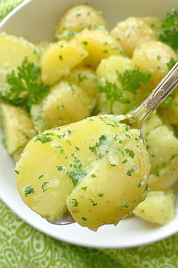 close up of parsley potato in a spoon