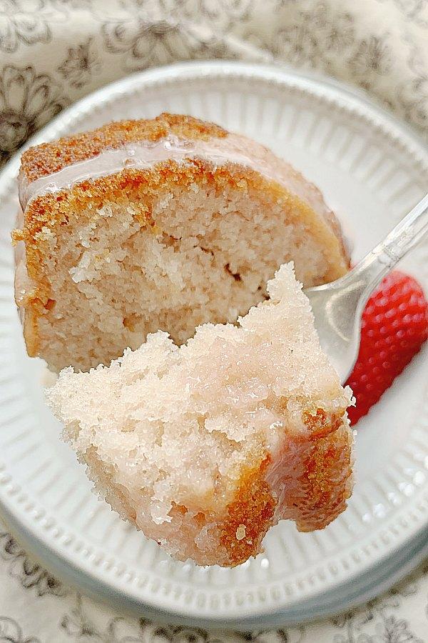 taking a bite of strawberry bundt cake