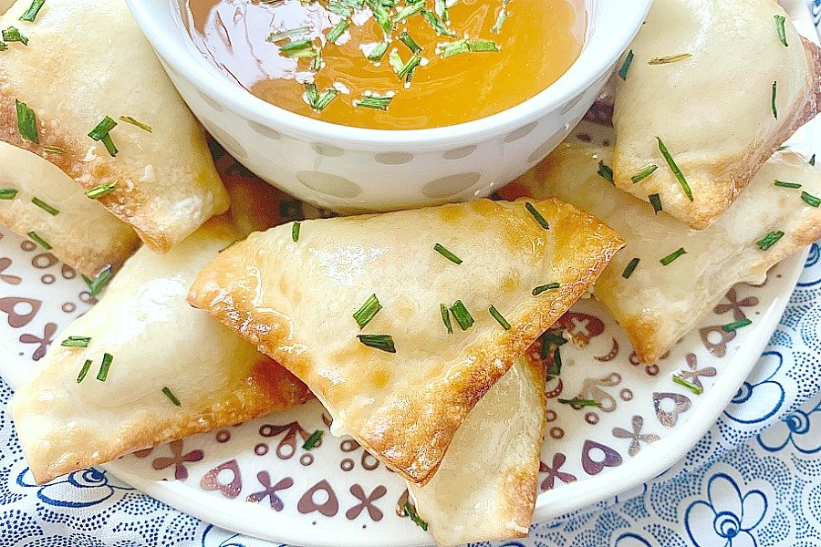 air fryer Crab Rangoon on a plate with dipping sauce