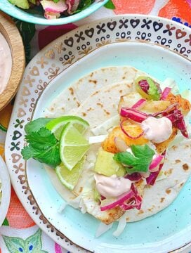 overhead view of open face fish taco garnished with lime