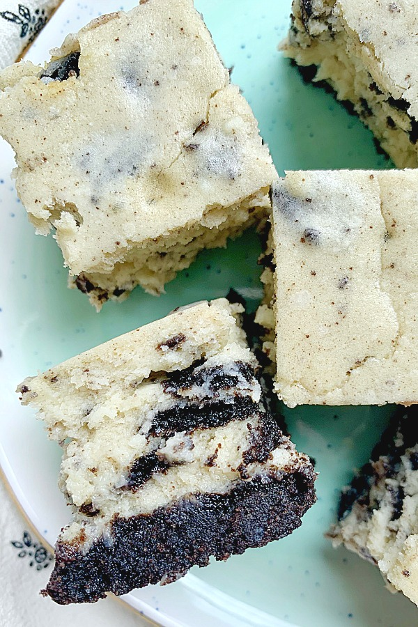 side view of oreo cheesecake bites on a plate