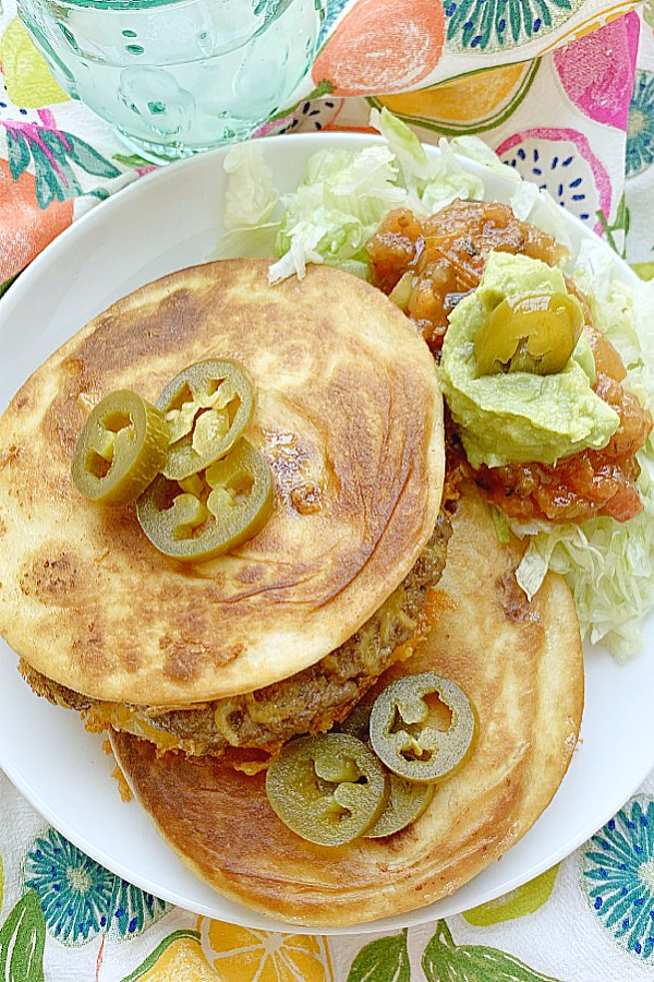 two quesadilla burgers on a plate