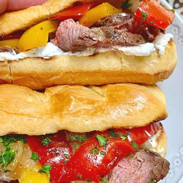 grilled steak sandwiches on a plate