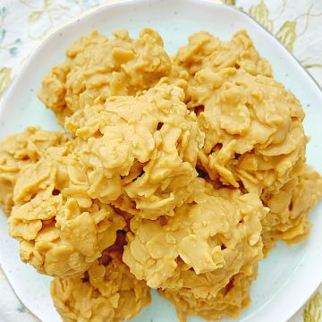 peanut butter cornflake cookies piled on a plate