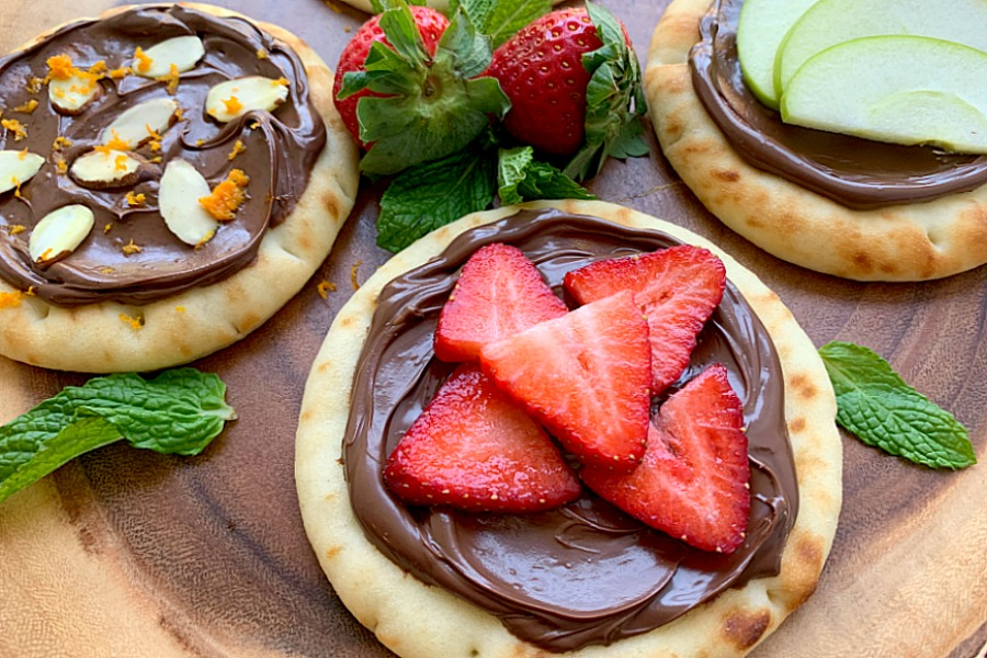 horizontal crop of strawberry nutella pizza on a platter