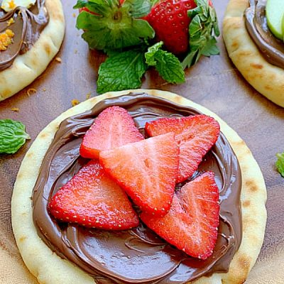 nutella pizza topped with strawberries