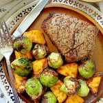 filet mignon on plate with air fried Brussels sprouts and sweet potatoes