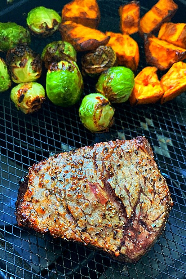 filet mignon, Brussels sprouts and sweet potatoes in the air fryer basket