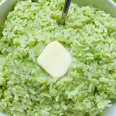 broccoli rice in a bowl topped with butter