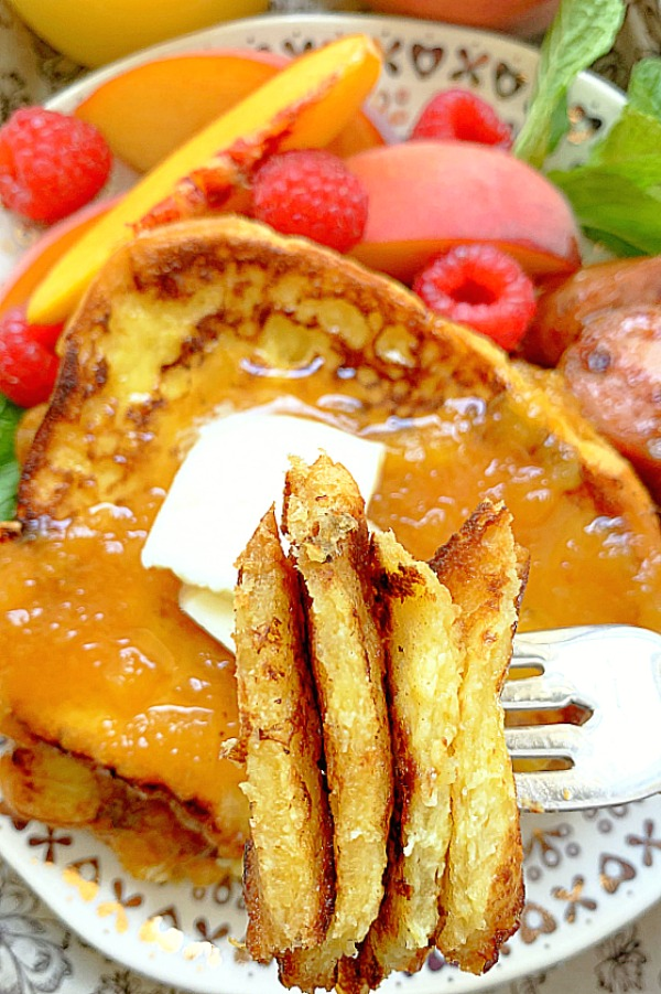 taking a bite of buttermilk french toast