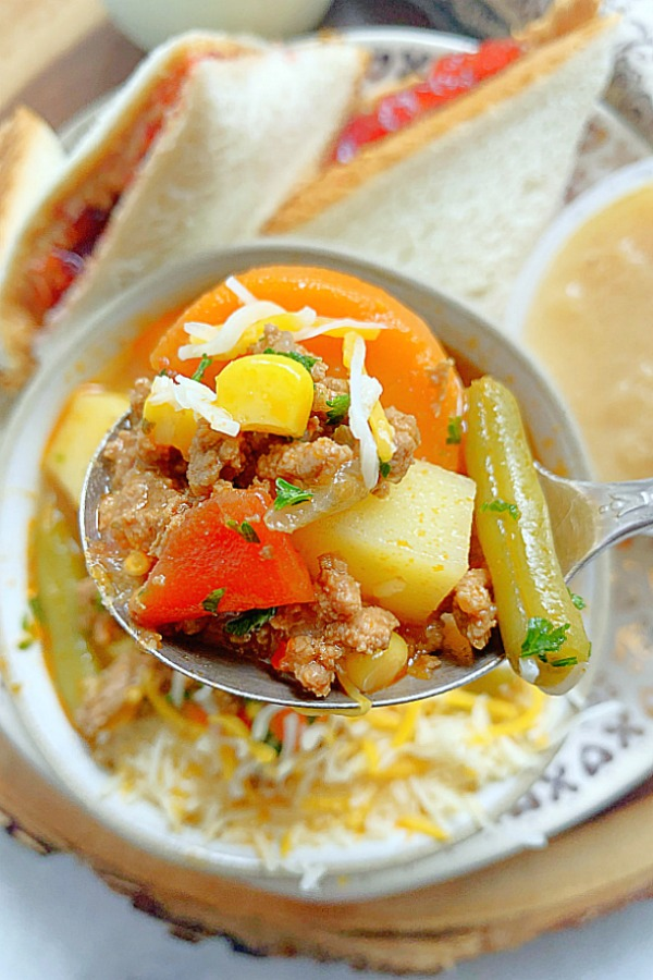 close up of a spoonful of campfire stew