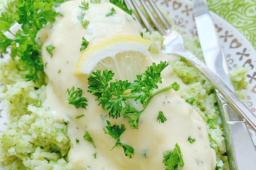 horizontal crop of creamy lemon chicken on a plate with broccoli rice