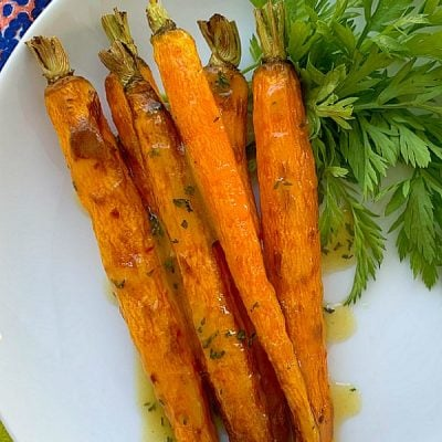 vertical crop of air fryer carrots on a plate
