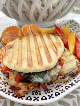 Panini Sandwich filled with steak, cheese, peppers and onions
