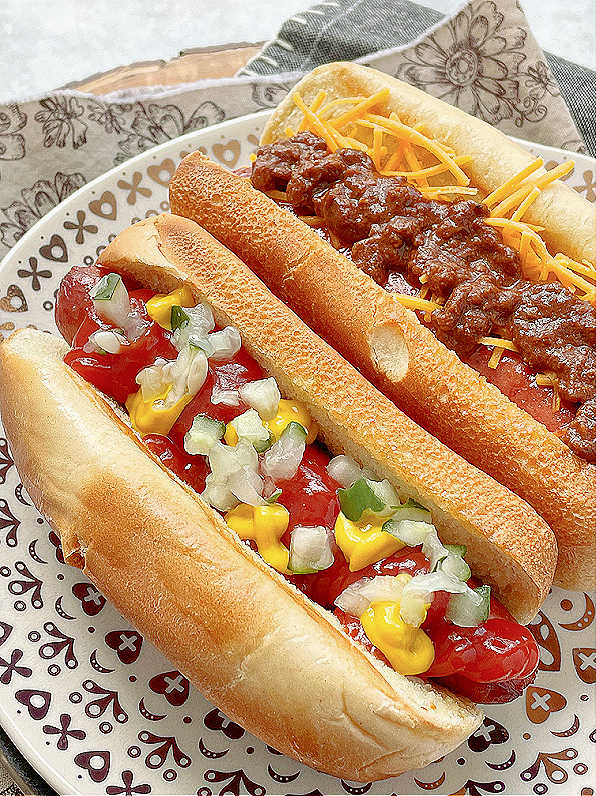 air fryer hot dog topped with ketchup, mustard and relish
