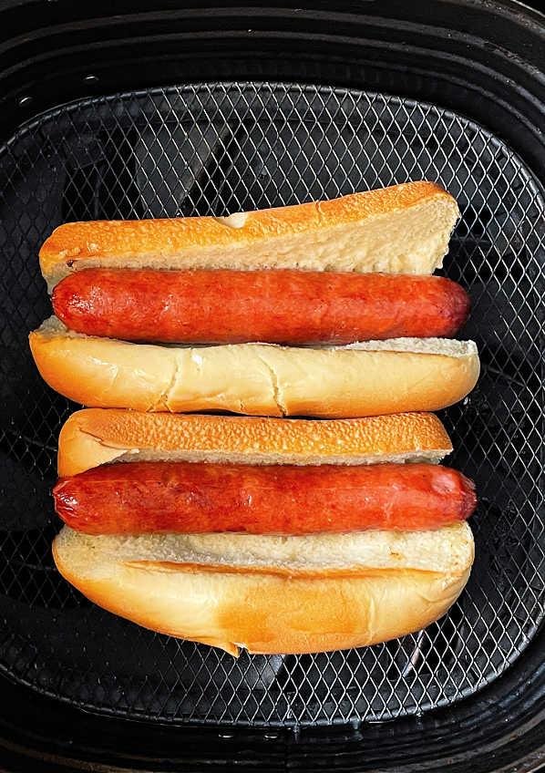air fryer hot dogs and buns in the basket of the air fryer