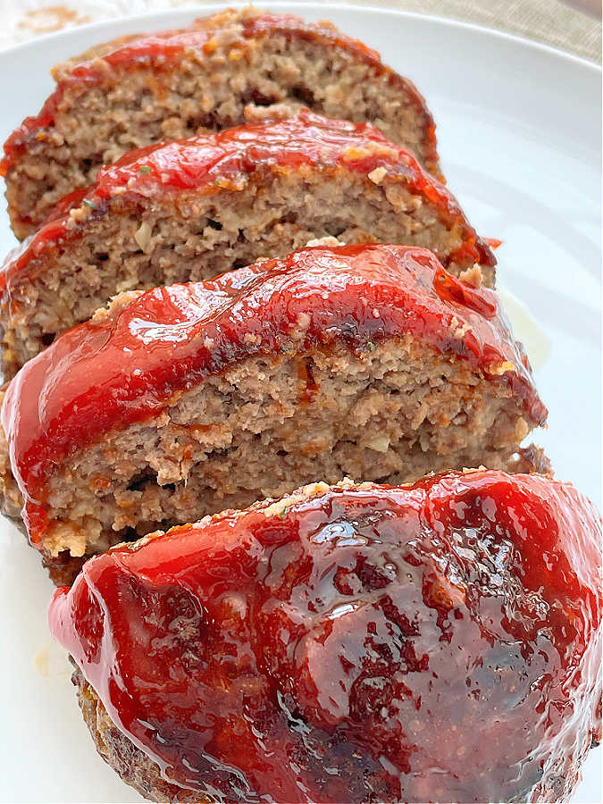 air fryer meatloaf sliced on a plate