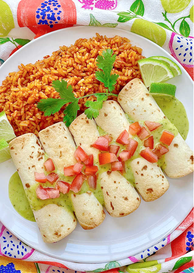 air fryer taquitos on a plate with rice