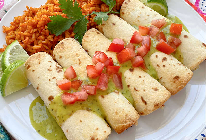 horizontal crop of air fryer taquitos on a plate