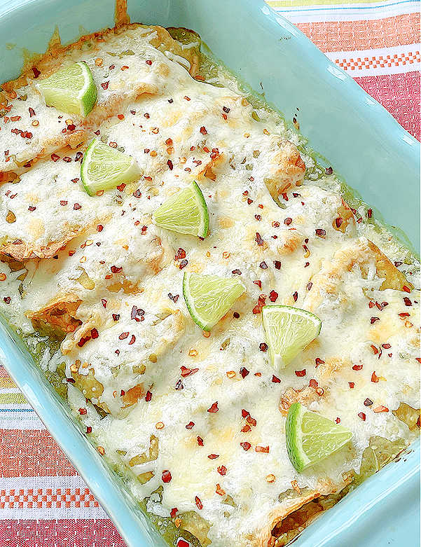enchiladas in the baking dish topped with lime slices