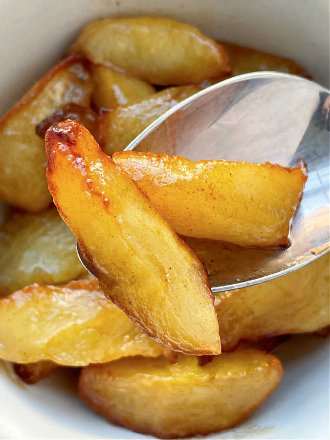 two air fryer apple slices in a spoon