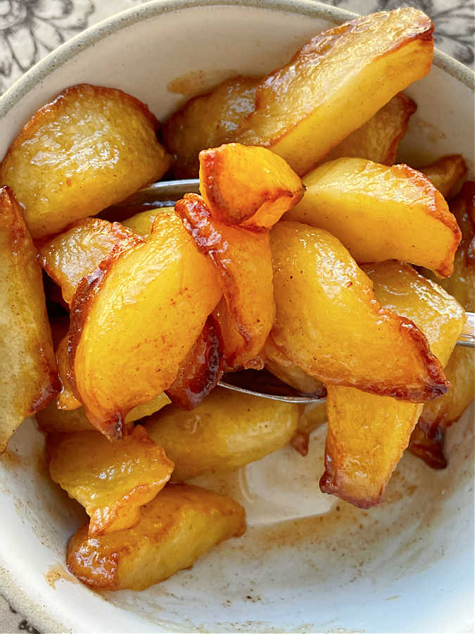 taking a bite of air fryer apples