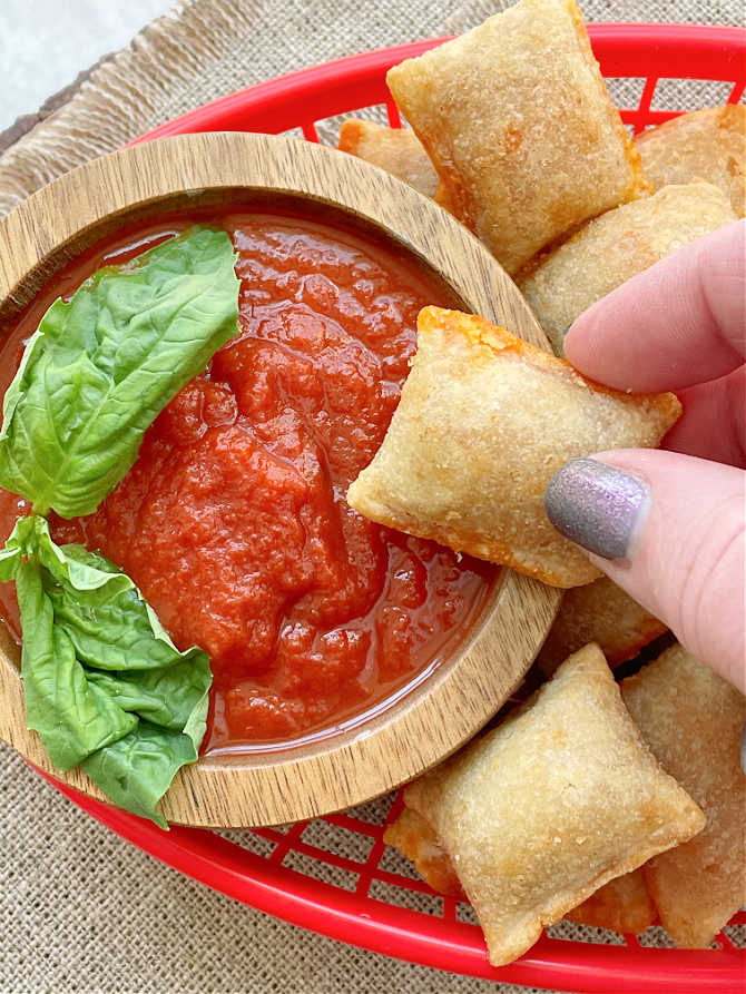 dipping a pizza roll in marinara sauce