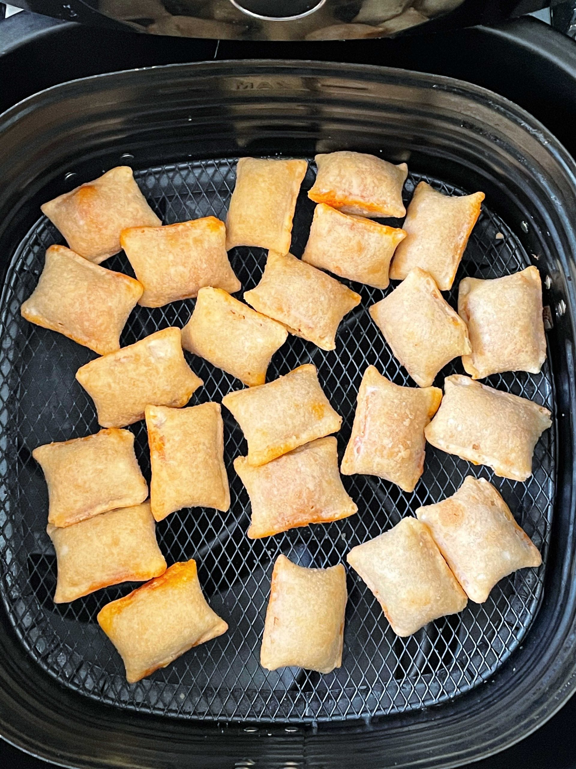 cooked pizza rolls in the air fryer basket