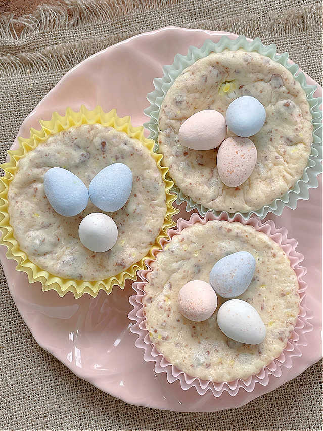 three mini egg cheesecakes on a pink plate