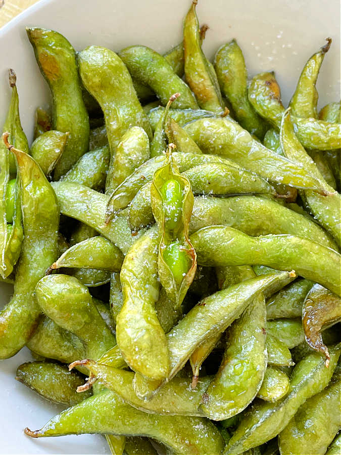 a bowl of roasted air fryer edamame