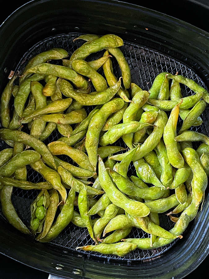 roasted edamame in the basket of the air fryer