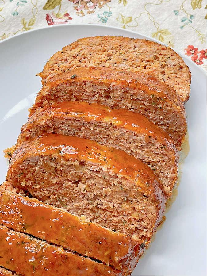 ham loaf sliced on a plate