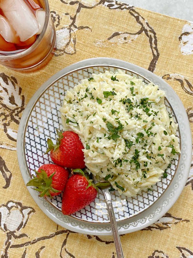 alfredo risoni plated up with fresh strawberries