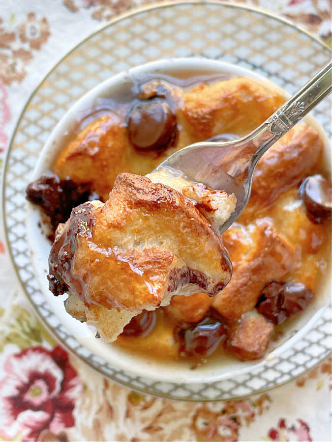 taking a bite of air fryer bread pudding