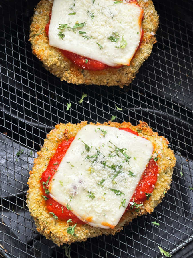 cooked chicken parmesan in the air fryer basket