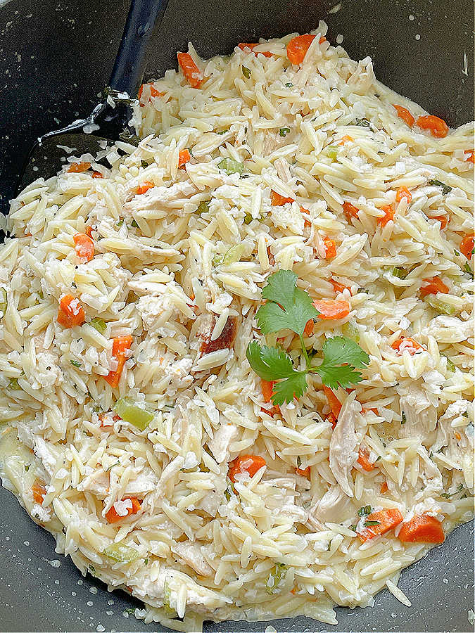 making creamy chicken risoni in a frying pan