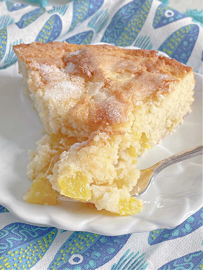 taking a bite of french pineapple cake