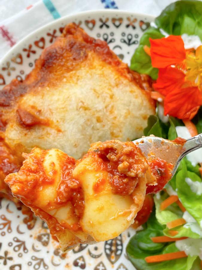 taking a bite of the delicious ravioli lasagna